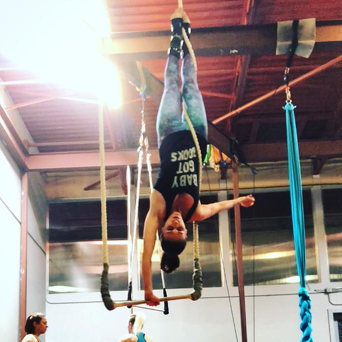 Shohreh does a one-armed handstand on the static trapeze as a way of embracing joyful movement in her life